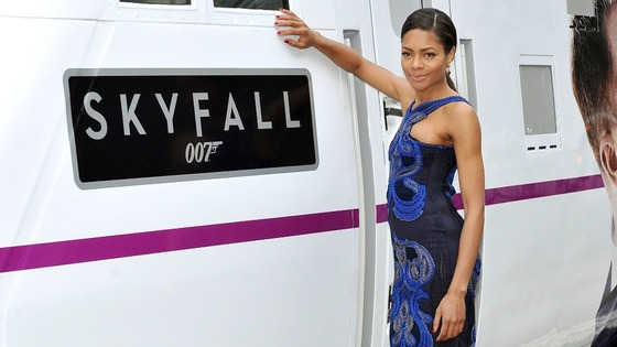 Skyfall star Naomie Harris stood aside an East Coast Train emblazoned with the film's logo.