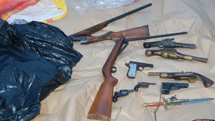 The selection of guns included a loaded shotgun and air rifles
