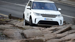 The Duchess of Cambridge drives a Land Rover Discovery as she takes part in an off-road driving experience in 2017.