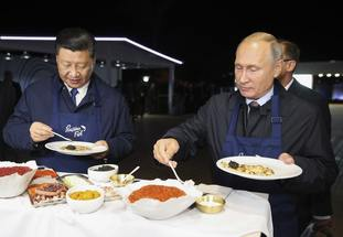 President Xi and President Putin tuck in