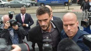 Tottenham goalkeeper Hugo Lloris (centre) arrives at Westminster Magistrates' Court.