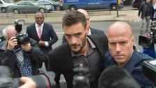 Tottenham goalkeeper Hugo Lloris (centre) arrives at Westminster Magistrates' Court.