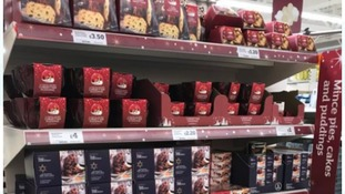 Supermarket stock of mince pies, Christmas pudding and cakes.