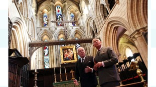 The Prince of Wales with Dr Tom Kelsey, Hexham Abbey Conservation Team, in the abbey's Chancel