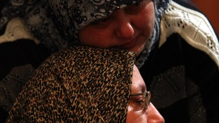 woman mourns for her son Ali Shaaban, a television cameraman who was shot dead on the Lebanon-Syria border.