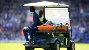 The midfielder was stretchered off.