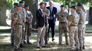 'Let's not talk about it' - Harry jokes about sharing tent with colleague as pair reunited during Royal Marines visit