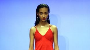 A model walks the catwalk at London Fashion Week.
