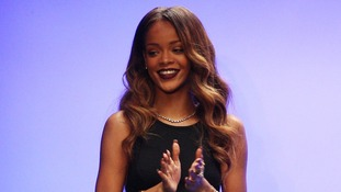 Rihanna appears after the Rihanna for River Island Autumn/Winter 2013 catwalk show on day two of London Fashion Week.