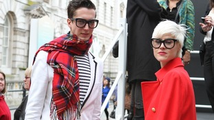 Fashionistas attend the London show.