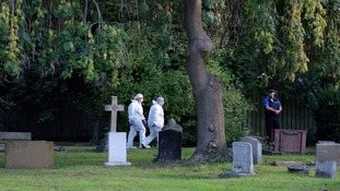 Police forensics could be seen examining an area in the cemetery.