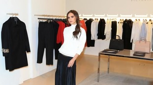 Victoria Beckham poses in front of one of her collections in Selfridges, Manchester.