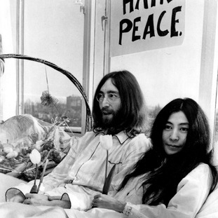 John Lennon and his wife, Yoko Ono, hold a bed-in for peace in Amsterdam on March 25, 1969.