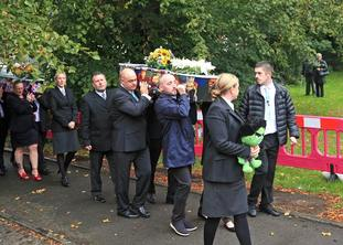 The coffins are carried into St Paul's Church