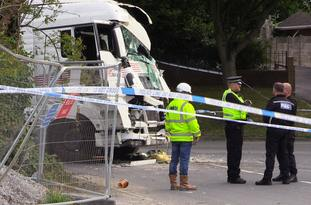 Lorry crashes into house