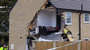 Before smashing into the house, the lorry hit a pedestrian.