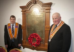 Senior Newtowncunningham Orangeman Stewart McClean (left) and Grand Master of the Orange Order Edward Stevenson pictured with the restored WW1 memorial