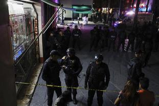 Police block access to the crime scene