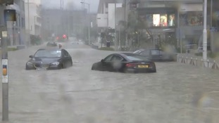 Vehicles were spotted submerged with water in the streets.