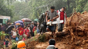 Rescuers work near the site of a landslide in Itogon in the Philippines.