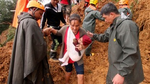 A mother and child are rescued from the landslide in Itogon.