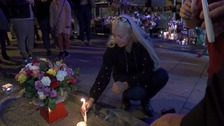 Hundreds attend candlelit vigil for popular nightclub owner
