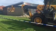 Man arrested after JCB crash into village supermarket
