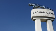 """Jaguar Land Rover has announced a cut in production due to """"continuing headwinds"""" affecting the car industry."""