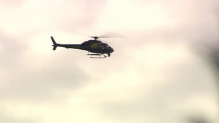 A man has been charged with shining a laser pen at a police helicopter.