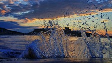 Waves building at sunset. DAVE CORKISH