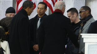 Barack Obama talks with Tiger Woods in January 2009