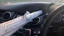Driver 'just escapes death' as metal poles smash through car