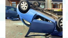 Driver safely removed from overturned car after crash