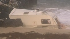 Woman dies after caravan blown off cliff during Storm Ali