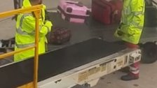 Baggage handlers at Manchester Airport.