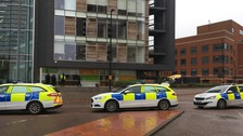 Armed police surround Cardiff Bay building