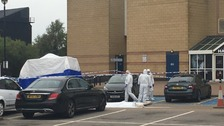 Forensic officers at the scene in Sheffield