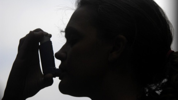 Woman with inhaler