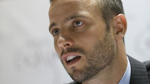 Oscar Pistorius seen speaking to the media in December 2012