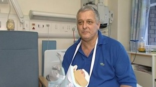 Mark Cahill with his new hand following the operation