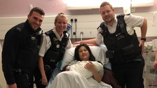Weihong Yu, her baby, and the police officers who helped them.