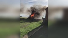 Tractor explodes as firefighters tackle flames