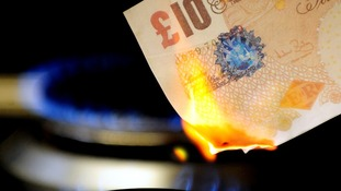 File photo of a £10 note burning on a gas hob.