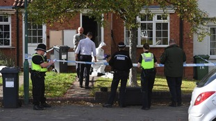 Police officers surrounding the house on Richmond Road in Solihull after a woman's body was found.