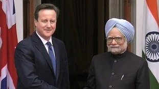 David Cameron shakes hands with India Prime Minister Manmohan Singh