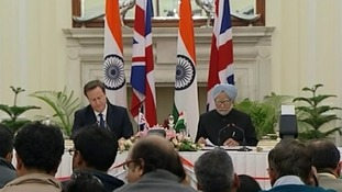 David Cameron and Prime Minister Manmohan Singh give a press conference