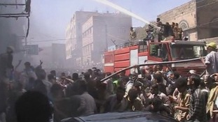 Crowds of people gather as firefighters try and put out the blaze.