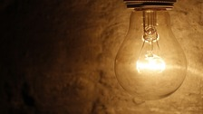 A general view of a lit light bulb.
