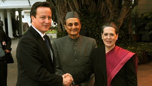 David Cameron shakes hands with Sonia Gandhi in New Delhi, India