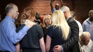 Oscar Pistorius' family console each other during a break in proceeding